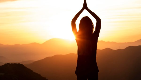 woman-sunset-doing-yoga